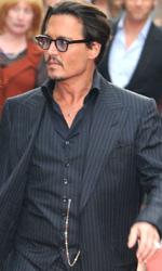 Nemico Pubblico, premiere a Londra - Johnny Depp con una misteriosa assistente