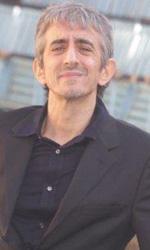 Riso amaro - Sergio Rubini al photocall del film <em>Qualunquemente</em>.