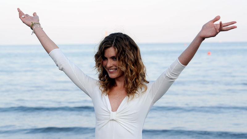 Mostra del Cinema di Venezia, al via la 68. edizione - La madrina della Mostra Vittoria Puccini all'immancabile photocall sulla spiaggia.
