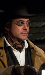 Sherlock Holmes 2, sfida d'abilità e intelletto - In foto Robert Downey Jr. e Jude Law in una scena del film Sherlock Holmes - Gioco di ombre di Guy Ritchie.