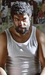 Pierfrancesco Favino, sulle spalle del gigante - In foto Pierfrancesco Favino in una scena del film Senza nessuna pietà di Michele Alhaique.