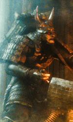 Baby Girl contro uno dei samurai giganti. -  Dall'articolo: Una mappa, il fuoco, un coltello e una chiave.
