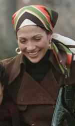 Jennifer Lopez e Marc Anthony nel film su Hector Lavoe - Hector, Puchi e il figlio Tito in una scena del film El cantante.