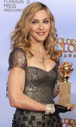 In foto Madonna (62 anni) Dall'articolo: Golden Globes, trionfano Paradiso amaro e The Artist.