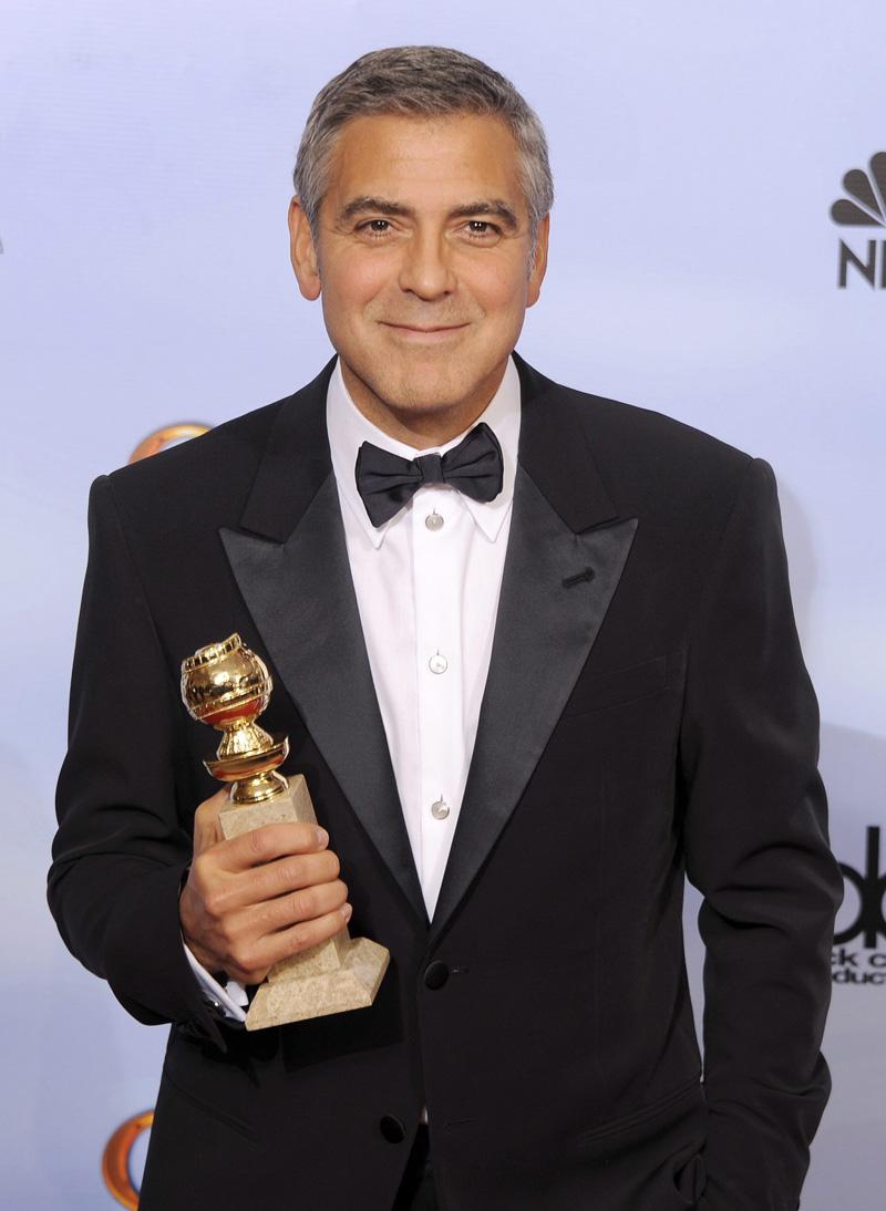In foto George Clooney (57 anni) Dall'articolo: Golden Globes, trionfano Paradiso amaro e The Artist.