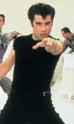 Dancing on the screen - In foto John Travolta in una scena del film Grease - Brillantina di Randal Kleiser.