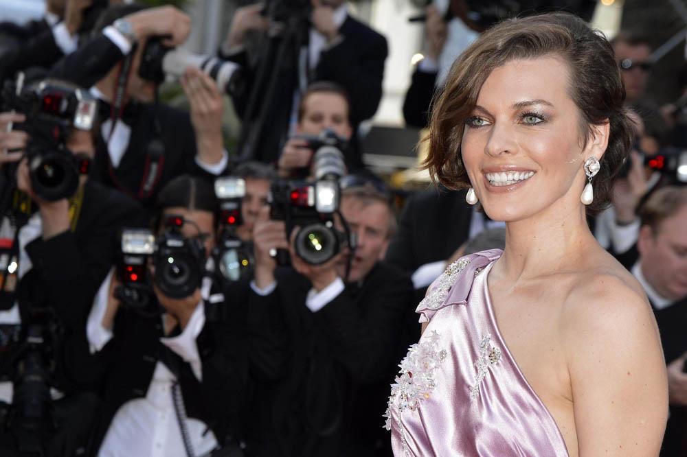 In foto Milla Jovovich (46 anni) Dall'articolo: Cannes 65, Bertolucci on the road.