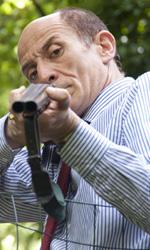 Paura 3D, le foto del film - Peppe Servillo imbraccia un fucile, pronto a sparare, in una scena del film Paura 3D dei Manetti Bros.