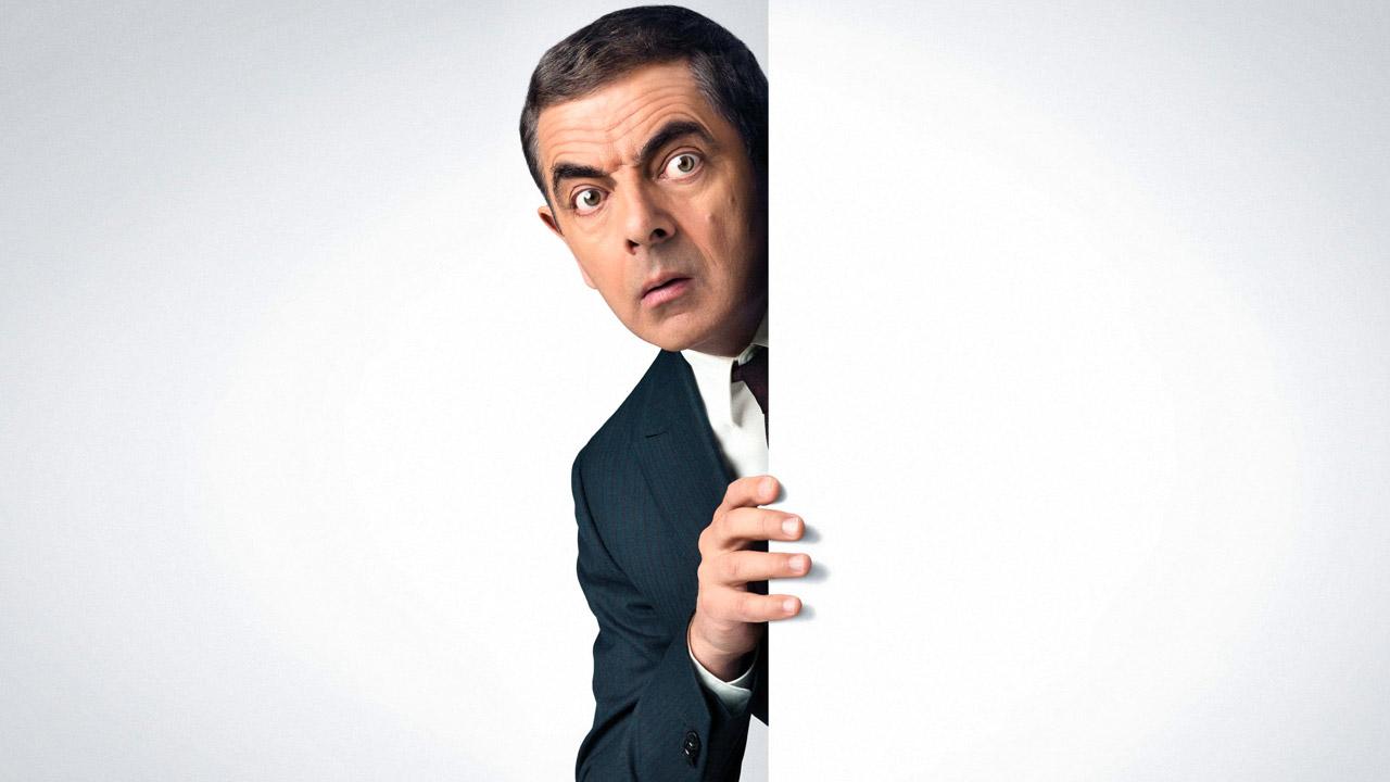 In foto Rowan Atkinson (65 anni) Dall'articolo: Johnny English colpisce ancora, una spia che è impossibile non amare.