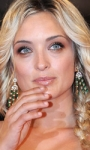 Fischi a Bellucci, flash per Madonna